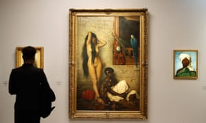 A visitor looks at The Slave for Sale (1873), a painting by Jean-Léon Gérôme at the Musée d'Orsay's exhibition Black Models: from Géricault to Matisse.