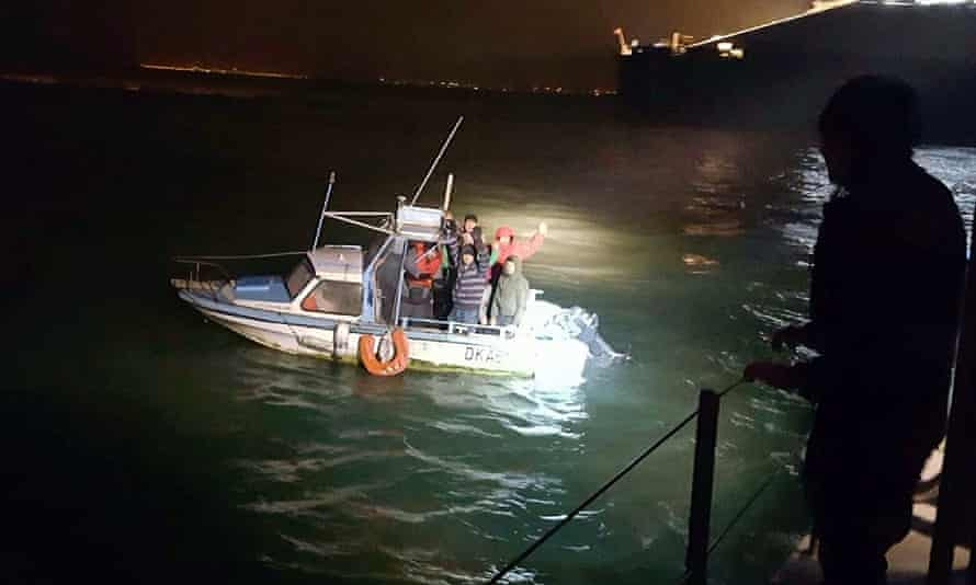 Iranian migrants being picked up by Fernch Coastguard (Gendarmerie Maritime) in Calais.