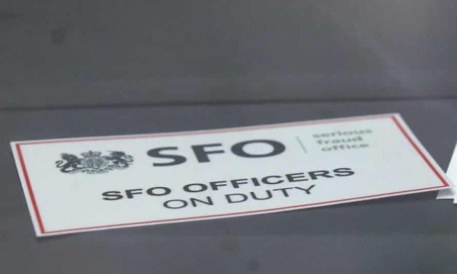 A sign is displayed in an unmarked Serious Fraud Office vehicle