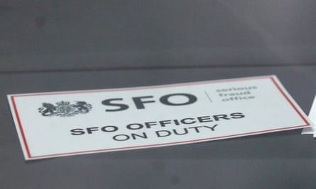 A sign on an unmarked Serious Fraud Office vehicle