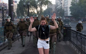 Santiago, Chile A woman cries while being escorted by police officers during an anti-government protest