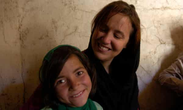 Barker with Nahida, a beggar she met on the streets of Kabul.