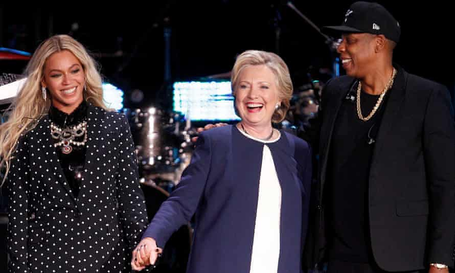 Hillary Clinton is joined on stage at a get-out-the-vote campaign by power couple Beyoncé and Jay Z.