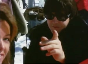 Paul McCartney points to the camera