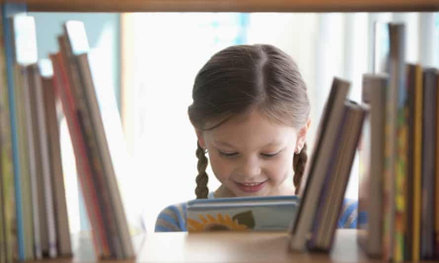 Caucasian girl taking book from shelf