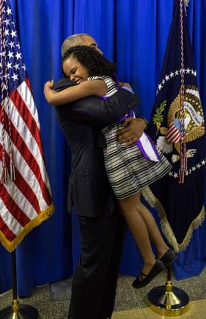 Obama hugs Mari Copeny, 8, backstage at Northwestern high school in Flint, Michigan