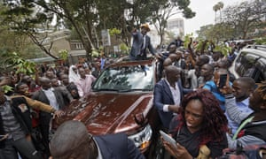 Odinga waves to supporters as he leaves the supreme court.