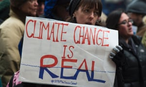 Activists rallying as part of a day of action against Donald Trump's climate denial cabinet