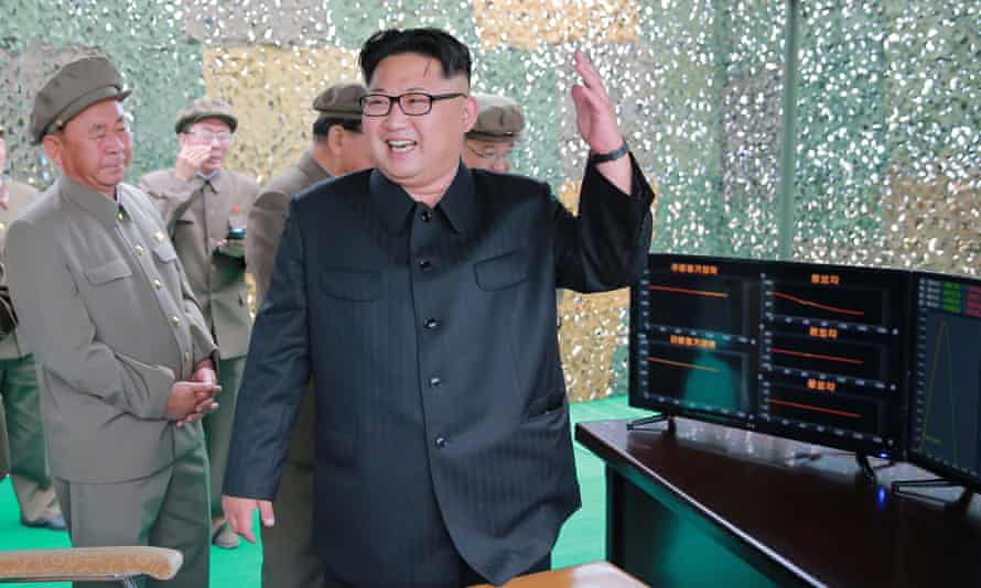 North Korean leader Kim Jong Un reacts during a test launch of ballistic rocket Hwasong-10. Pyongyang has rejected the UN's criticism of its latest tests.