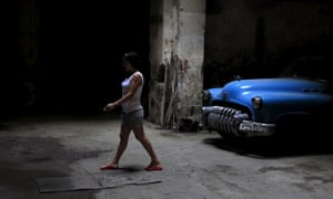While awaiting the arrival of US President Barak Obama, photographers have been capturing daily life in Cuba. Here a woman walks past a 1952 Buick car in Havana.