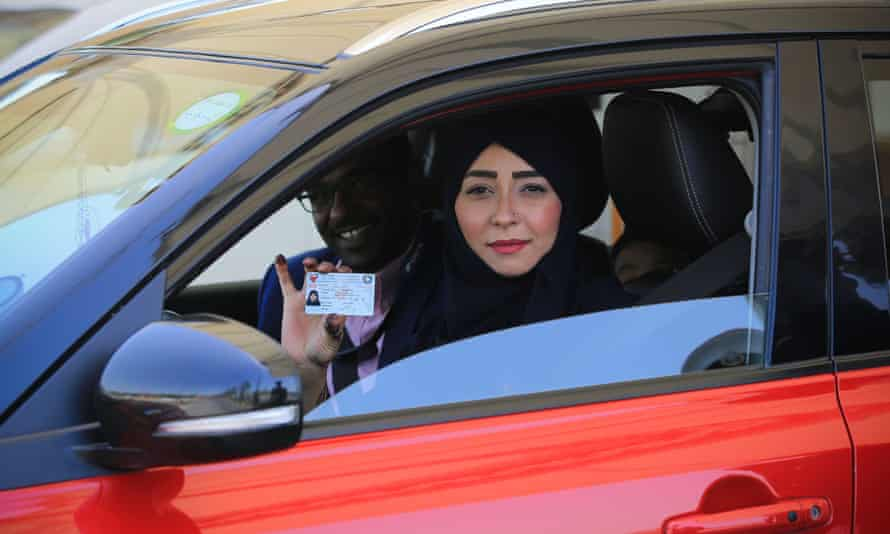 A Saudi woman shows her driving licence