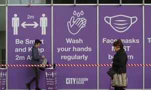 Social distancing sign outside City of Glasgow College