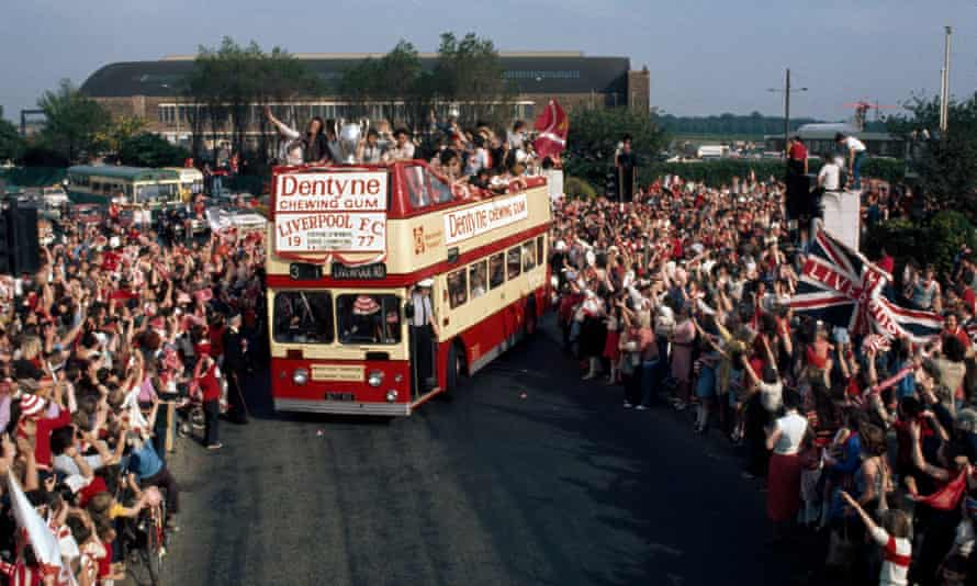 Liverpool fans line the streets as the team parade their first European Cup in 1977.