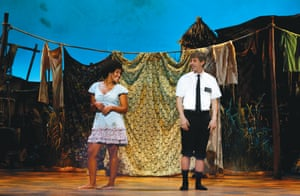 Zahra Newman as Nabulungi and AJ Holmes as Elder Cunningham in The Book of Mormon
