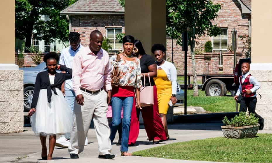 People walk to a Palm Sunday service at Life Tabernacle church in Baton Rouge, Louisiana, despite statewide stay-at-home orders due to the coronavirus pandemic.