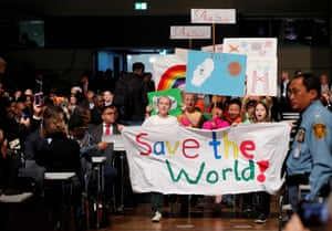 Children take part in a climate march prior to the opening session. New data shows how the world would look if governments fail in their pledge to hold global warming to 2C.