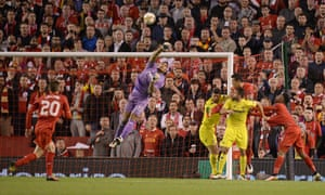 The unconvincing Alphonse Areola punches the ball.