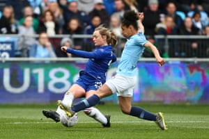 Erin Cuthbert of Chelsea is tackled by Demi Stokes of Manchester City