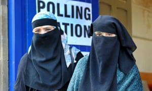 Women wearing niqabs leave a polling station in Luton in May 2015