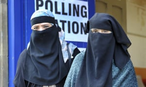 Women in niqabs at a polling station