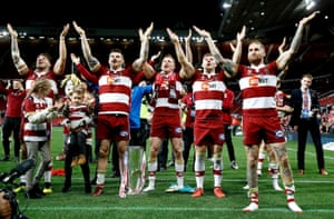 Wigan Warriors' Sam Tomkins (right) and his teammates acknowledges the crowd as they celebrate their victory.