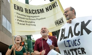 White people participate in a march on Tuesday organised by the Syracuse Peace Council to protest against racism and the murders of nine people in a black church in Charleston, South Carolina.