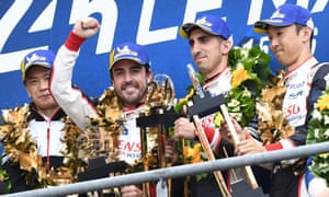 Fernando Alonso, second left, Sebastien Buemi and Kazuki Nakajima (right) celebrate on podium after winning the 87th edition of the Le Mans 24 Hours race.