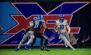 St. Louis Battlehawks quarterback Jordan Ta'amu (10) tries to elude Dallas Renegades safety Micah Abernathy (21) in the XFL.
