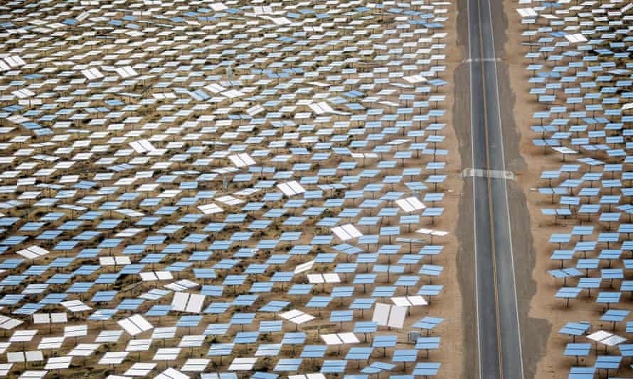 A road divides solar panels at the Ivanpah Solar Electric Generating System in the Mojave Desert, Nevada