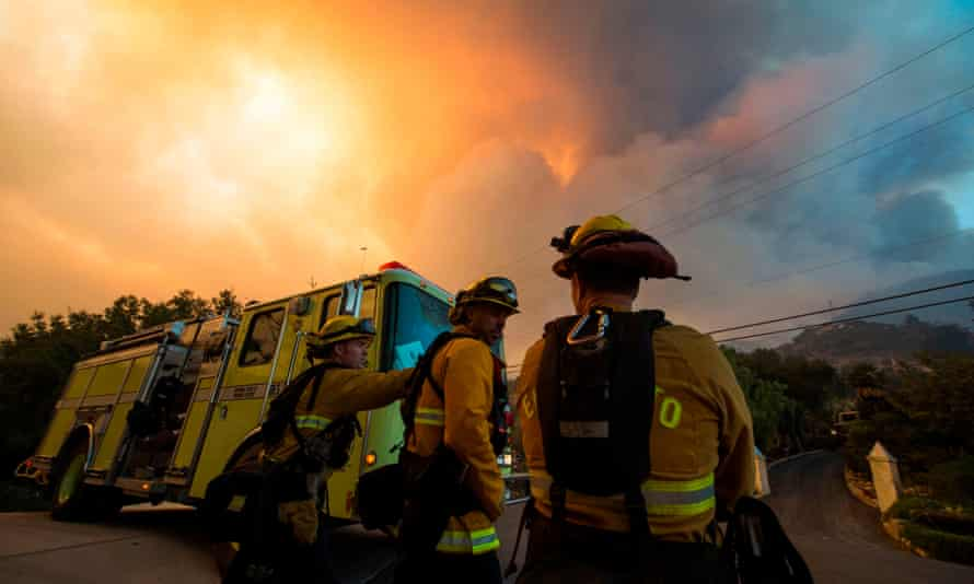 Firefighters monitor the advance of smoke and flames from the Thomas fire in 2017.