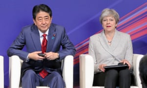 Theresa May and Shinzo Abe in Japan last year.