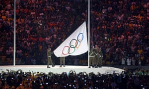 The olympic flag is raised during the opening ceremony at Maracana Stadium.