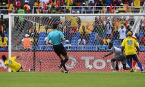 Pierre-Emerick Aubameyang, left, slides in to give Gabon the lead.