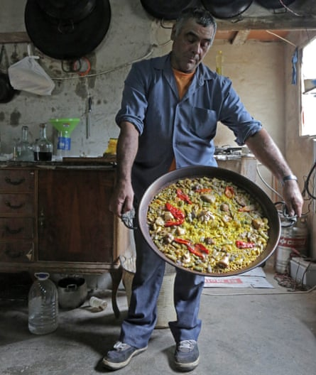 Evaristo with his paella.