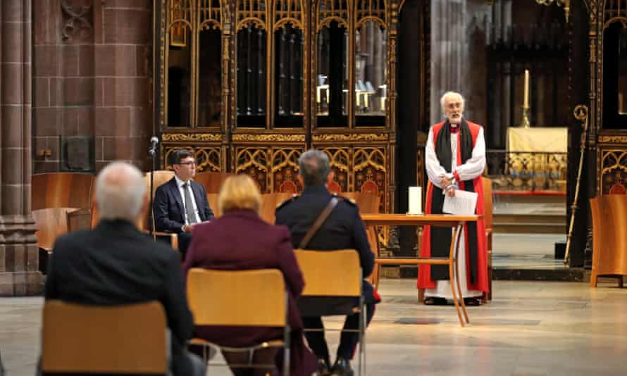 David Walker, bishop of Manchester, leading a memorial service for Covid victims alongside the mayor, Andy Burnham, at Manchester Cathedral last July.