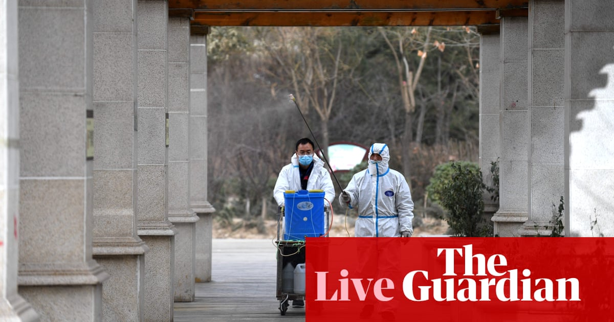 Coronavirus live news: pharmacies in England begin vaccine rollout as WHO team arrives in Wuhan – The Guardian