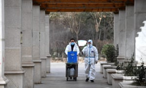 Staff members spray coronavirus disinfectant in Yuhua District of Shijiazhuang, north China's Hebei Province, 12 January 2021.