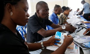 Officials  count ballot paper