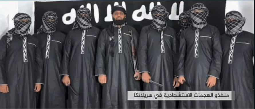 An image grab from a press release issued by the Isis agency Amaq allegedly shows men who carried out the bombings. The man in the centre is believed to be Hashim.