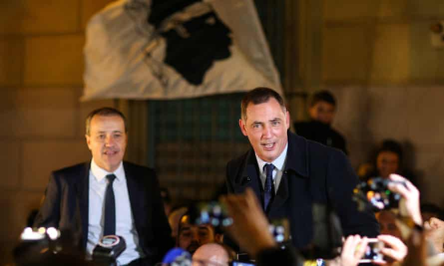 Gilles Simeoni (right) and Jean-Guy Talamoni celebrate their victory in the second round of regional elections.