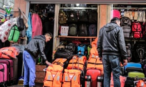 Life jackets and travel bags on sale at a store in Kumkapi district of Istanbul.