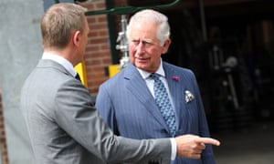 Here we witness a grave error in protocol. Daniel Craig, full of movie-star bravado, has attempted to do a point in the face of Prince Charles, a man who literally points at things for a living. You can see the severity of the mistake from the enraged expression on Charles' face. Protocol dictates that such a lapse must be punished in the traditional way: by making Craig endure a 45-minute display of Prince Charles pretending to pop out from behind a wall