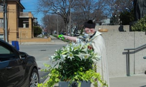 Timothy Pelc conducts the traditional Blessing of the Easter Baskets at St Ambrose Catholic church in April.