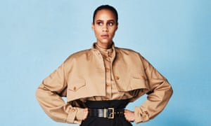 Making a stand: Ashton wears beige shirt, jacket, high-waisted trousers and belt, all by givenchy.com.
