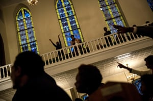 Mourners hold a prayer vigil at the First African Methodist Episcopal Church: Bethel, Harlem, New York City.