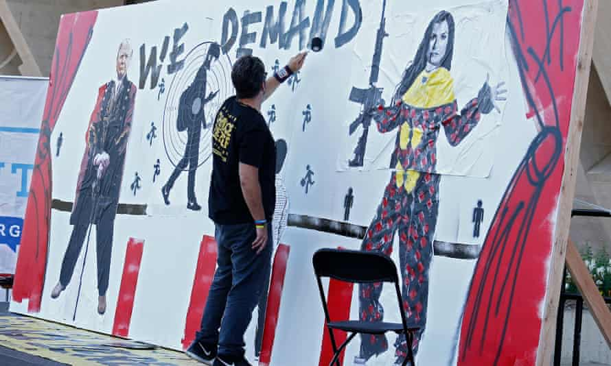 Oliver's mural depictesa student wearing a backpack in the crosshairs of a gun, flanked by Trump and NRA spokeswoman Dana Loesch.