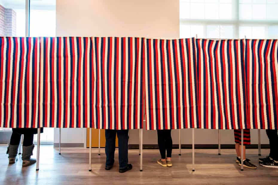 Voters fill in their ballots at polling booths in Concord, New Hampshire, on 3 November 2020.