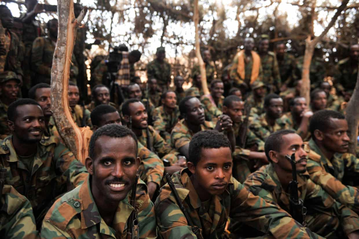 Ethiopian soldiers serving under the African Union Mission in Somalia (AMISOM) listen to a speech by the the AMISOM Acting Force Commander, Maj. Gen. Nakibus Lakara (not in picture) in Halgan village, Hiran region, Somalia on June 10, 2016. This was after a battle with Al-Shabaab militants on June 09, 2016. Maj. Gen. Lakara said more than 140 Al-Shabaab militants were killed in the battle.