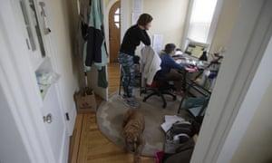 Rebecca Biernat watches as her son Seamus Keenan, 6, takes a live class online at their home in San Francisco.