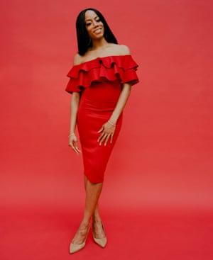 Dawnn Karen in a red cocktail dress